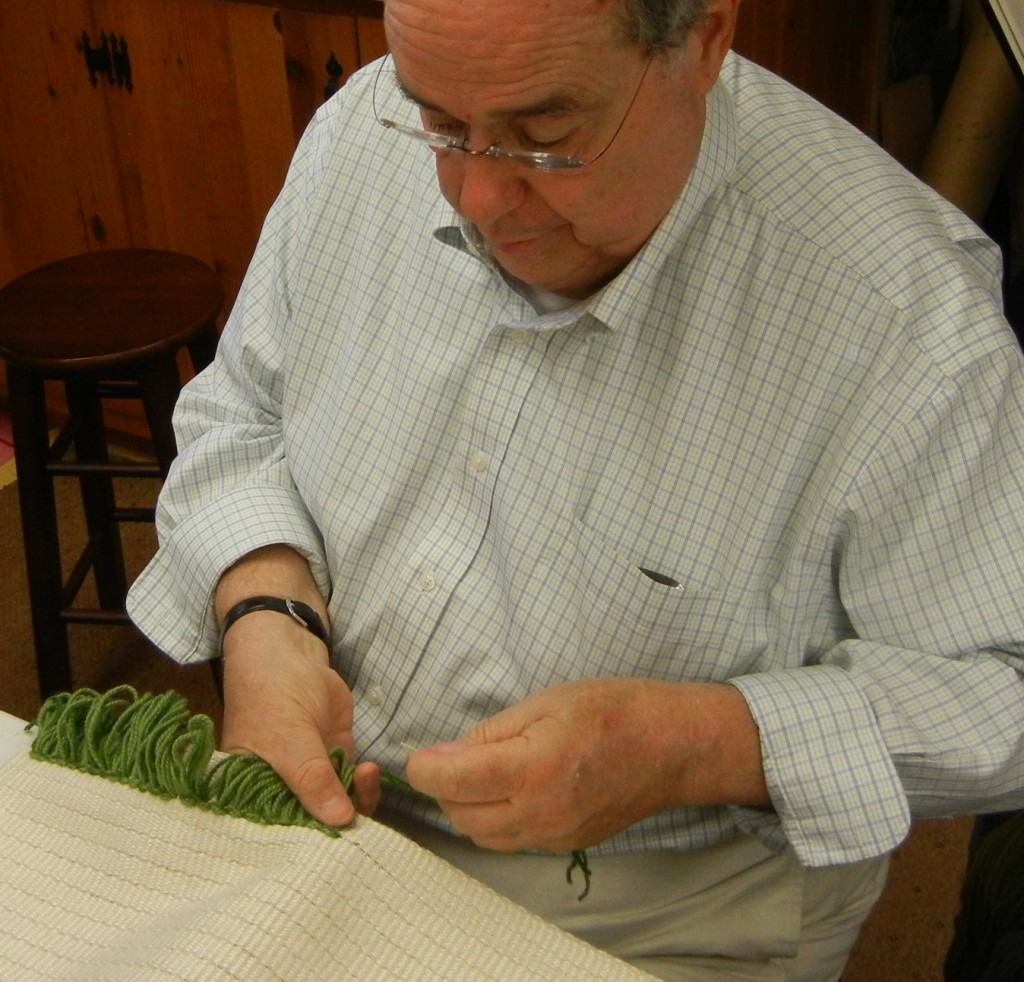 Bill getting more comfortable by the minute with the knotting process.