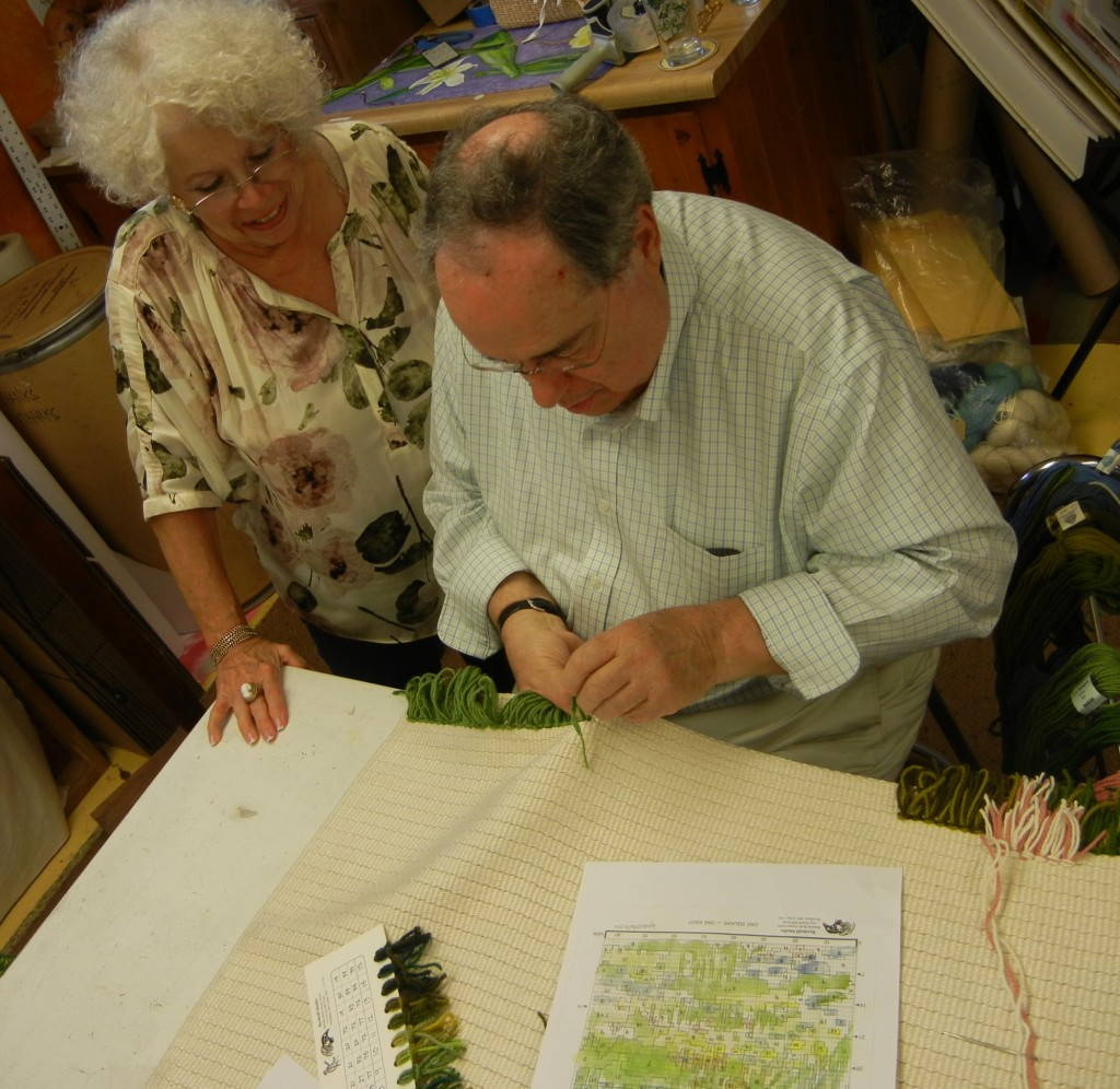 Bill and Emilie learn the rya knotting process for both left-handed and right-handed stitching.